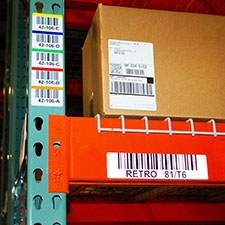 Warehouse location rack labels readable from long distance by using correct barcode X dimension and label material to improve barcode scanning.