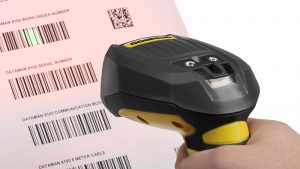 Cognex fixed barcode reader reads through stretch wrap to improve barcode scanning.